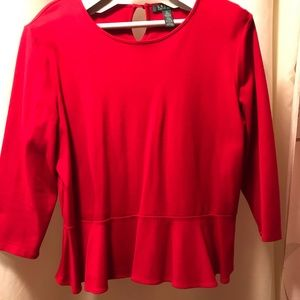 Ladies red blouse with 3/4 length sleeves.